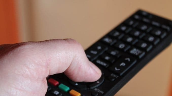 hand holding smart tv remote